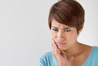 Woman with Tooth Pain | Emergencies in Bayside VIC