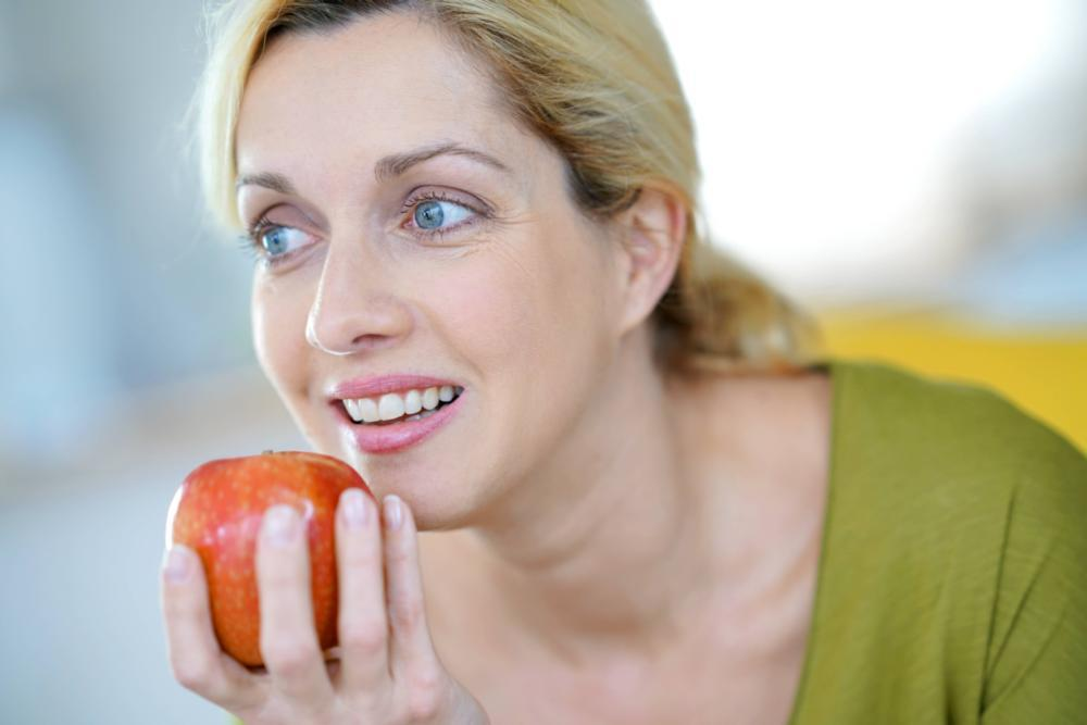 Woman Eating an Apple | Dietary Choices and Oral Health
