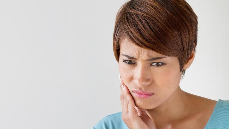 Woman With Tooth Pain | Sparkle Dental Care