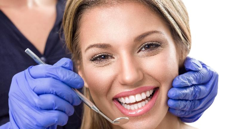 Smiling Woman at the Dentist | Sparkle Dental Care