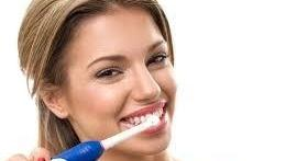 Woman Brushing Teeth | Fairfield Dentist