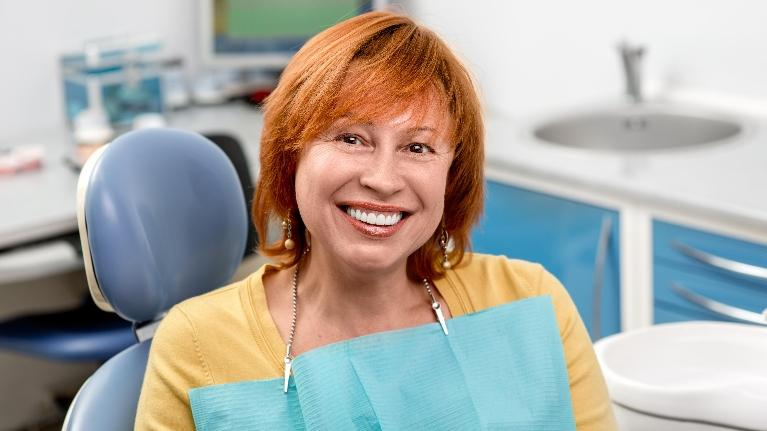Woman Smiling at the Dentist | Sparkle Dental Care