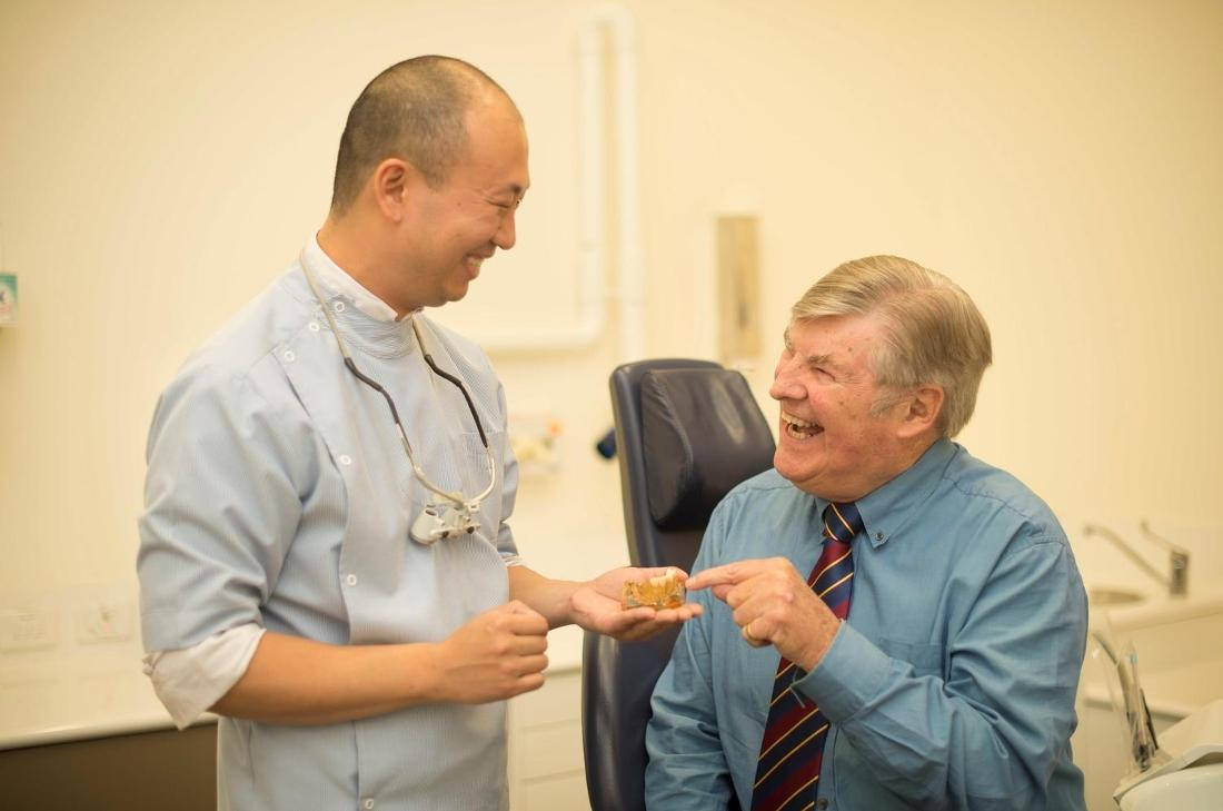 Dr. Xu and Patient | Hampton Dental Clinic